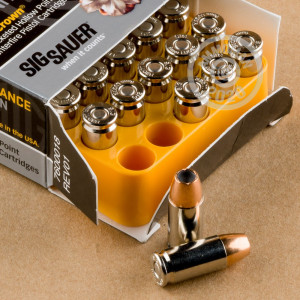 Image detailing the nickel-plated brass case and boxer primers on the SIG ammunition.