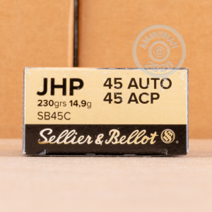 A photograph of 50 rounds of 230 grain .45 Automatic ammo with a JHP bullet for sale.