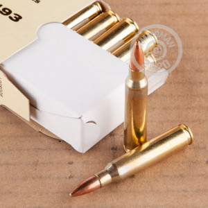 A photograph of 20 rounds of 55 grain 5.56x45mm ammo with a FMJ-BT bullet for sale.