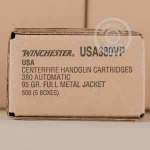A photograph detailing the .380 Auto ammo with FMJ bullets made by Winchester.