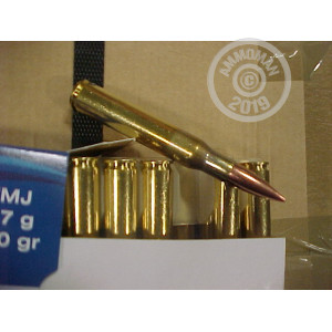 A photograph of 500 rounds of 150 grain 30.06 Springfield ammo with a FMJ bullet for sale.