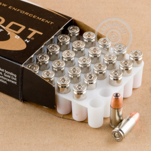 A photograph detailing the 9mm Luger ammo with JHP bullets made by Speer.