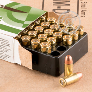A photograph detailing the .32 ACP ammo with FMJ bullets made by Remington.