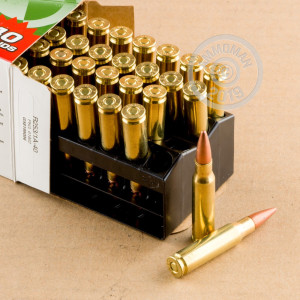 A photograph detailing the 308 / 7.62x51 ammo with metal case bullets made by Remington.
