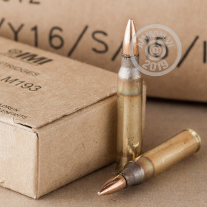 A photograph detailing the bulk 5.56x45mm ammo with FMJ bullets made by Israeli Military Industries.