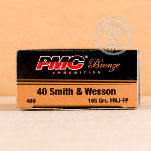 A photograph detailing the .40 Smith & Wesson ammo with FMJ bullets made by PMC.
