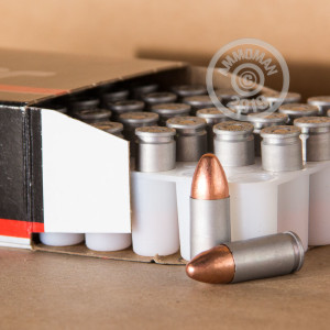 A photograph detailing the 9mm Luger ammo with TMJ bullets made by Blazer.