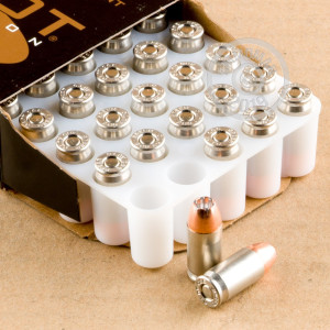 A photograph of 50 rounds of 90 grain .380 Auto ammo with a JHP bullet for sale.