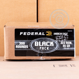 Photo detailing the 223 REMINGTON FEDERAL AMERICAN EAGLE BLACK 55 GRAIN FMJBT (300 Rounds) for sale at AmmoMan.com.