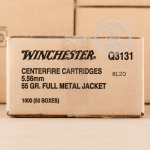 A photograph of 1000 rounds of 55 grain 5.56x45mm ammo with a FMJ bullet for sale.