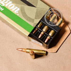 A photograph of 20 rounds of 77 grain 223 Remington ammo with a Hollow-Point Boat Tail (HP-BT) bullet for sale.