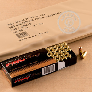 A photograph detailing the bulk .380 Auto ammo with FMJ bullets made by PMC and commonly used for training at the range.