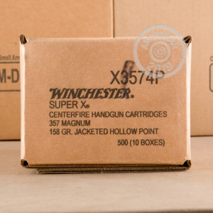 A photograph of 50 rounds of 158 grain 357 Magnum ammo with a JHP bullet for sale.