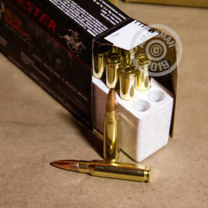 A photograph of 20 rounds of 150 grain 308 / 7.62x51 ammo with a HP bullet for sale.