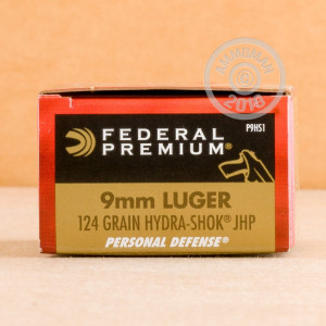 A photograph of 20 rounds of 124 grain 9mm Luger ammo with a JHP bullet for sale.