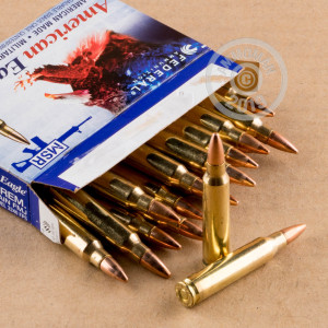 A photograph of 500 rounds of 55 grain 223 Remington ammo with a FMJ bullet for sale.