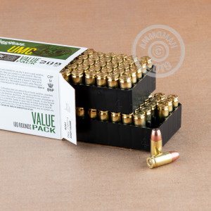 A photograph of 100 rounds of 115 grain 9mm Luger ammo with a JHP bullet for sale.