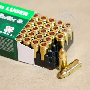 A photograph detailing the 9mm Luger ammo with TMJ bullets made by Sellier & Bellot.