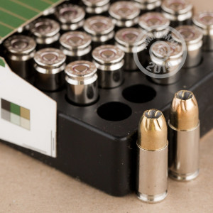 A photograph of 500 rounds of 147 grain 9mm Luger ammo with a JHP bullet for sale.