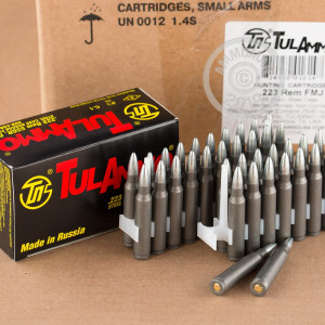 A photograph of 40 rounds of 55 grain 223 Remington ammo with a FMJ bullet for sale.
