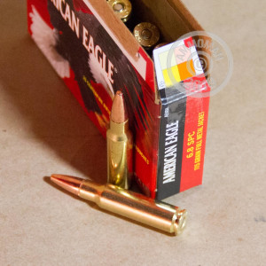 A photograph of 20 rounds of 115 grain 6.8 SPC ammo with a FMJ bullet for sale.