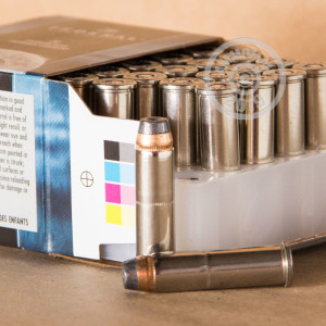 A photograph of 20 rounds of 180 grain 357 Magnum ammo with a JHP bullet for sale.