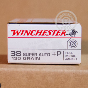 A photograph detailing the 38 Super ammo with FMJ bullets made by Winchester.