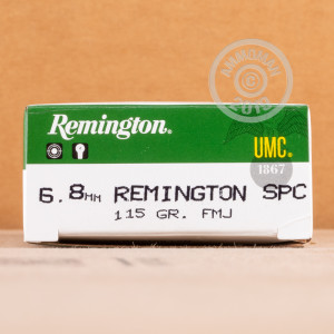 A photograph detailing the 6.8 SPC ammo with metal case bullets made by Remington.