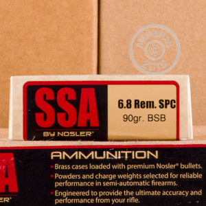 A photograph of 20 rounds of 90 grain 6.8 SPC ammo with a bonded soft point bullet for sale.