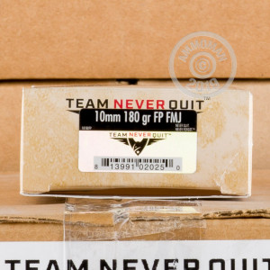 Image detailing the brass case and boxer primers on the Team Never Quit ammunition.