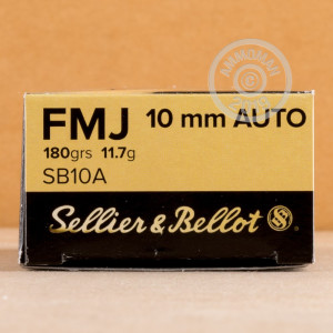 A photograph detailing the 10mm ammo with FMJ bullets made by Sellier & Bellot.