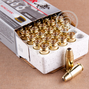A photograph detailing the 9mm Luger ammo with brass enclosed base bullets made by Winchester.