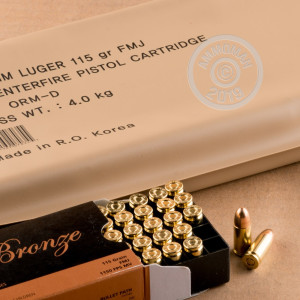 Image detailing the brass case and boxer primers on 300 rounds of PMC ammunition.