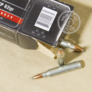 A photograph of 20 rounds of 62 grain 223 Remington ammo with a soft point bullet for sale.