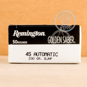 A photograph detailing the .45 Automatic ammo with JHP bullets made by Remington.