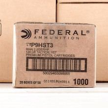 A photograph of 1000 rounds of 124 grain 9mm Luger ammo with a JHP bullet for sale.