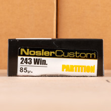 Image of 243 Winchester ammo by Nosler Ammunition that's ideal for hunting wild pigs, whitetail hunting.